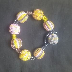 Hand crafted bracelet and complimenting earrings